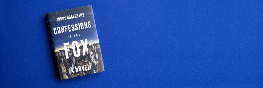 A hardcover edition of Confessions of the Fox by Jody Rosenberg sits on a blue background.