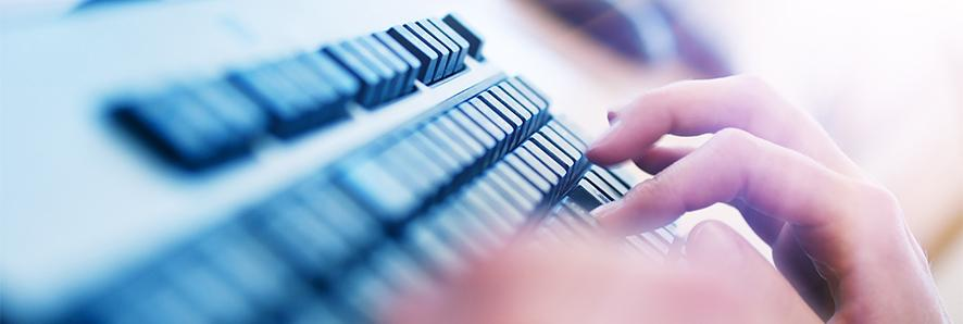 close up of typing on computer keyboard