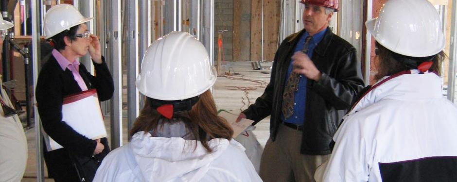Capital Projects Manager Henry Merriman giving a tour of the Skinner Hall renovation