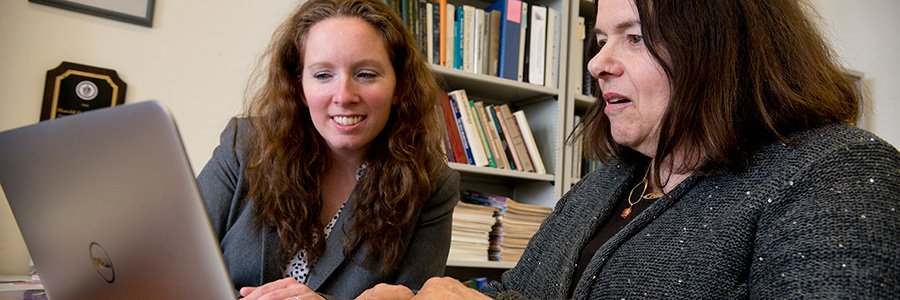 Program assistant Lisa Fiorenzo works on an MCS project with Dr. Aline Sayer.
