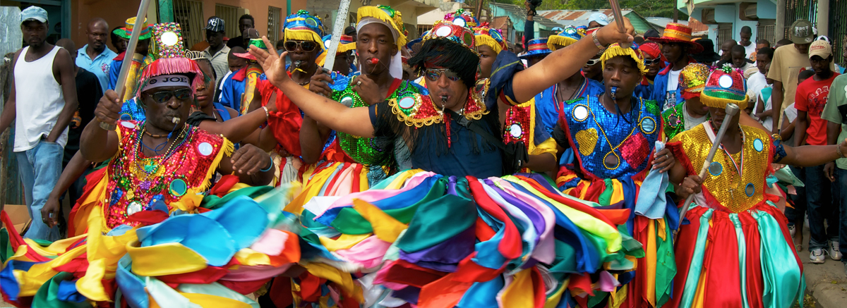 Colorfully dressed Rara festival music performers in Haiti