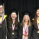 Our beaming graduates: Sarah Vusijic, Julia Laughlin, Daniel Riecker, Emily Hamel, Justine Maloberti, Sarah Hickey, Emily Cooper, and Anna Kadinoff