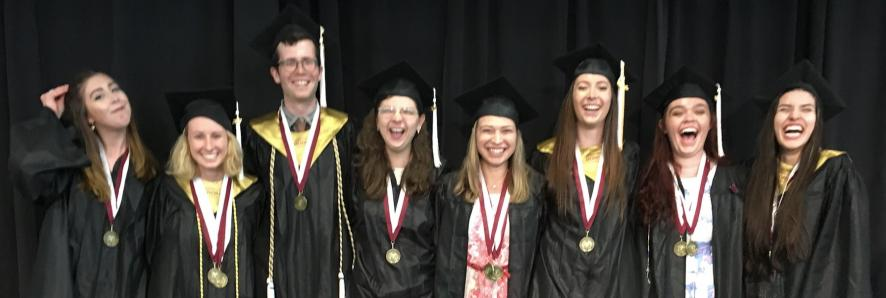 Our beaming graduates: Sarah Vusijic, Julia Laughlin, Daniel Riecker, Emily Hamel, Justine Maloberti, Sarah Hickey, Emily Cooper, and Anna Kadinoff