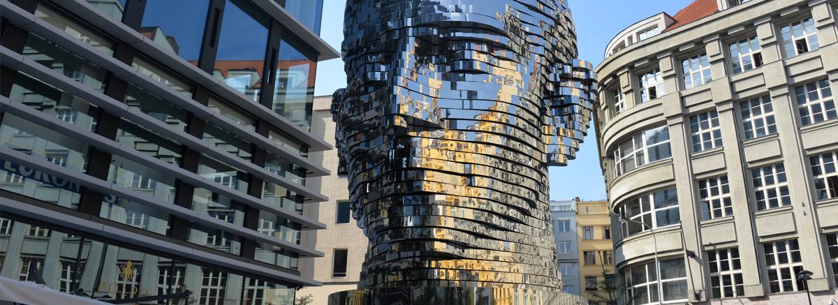 Statue of Franz Kafka by artist David Cerny in Prague, Czech Republic.