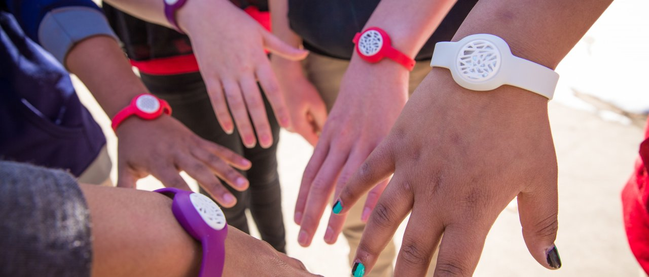 Closeup of Hands and Data Collecting Wristbands