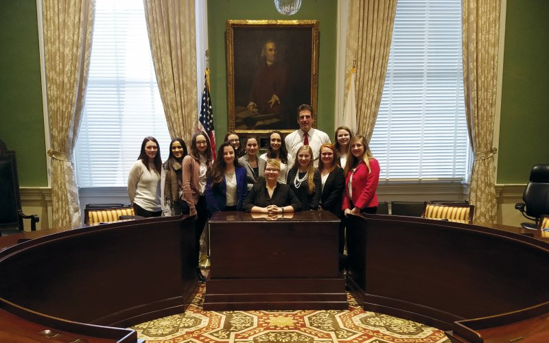 UWiL students pose withJay Ash former MA sevretary of Housing and Economic Development