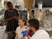 Heather Hamilton, simulation lab director, left, with nursing students.