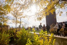 Students walking on UMass campus in fall