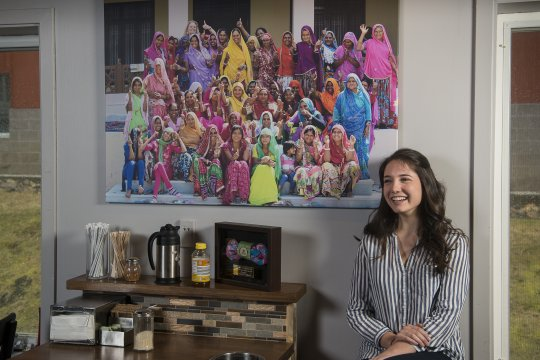 Gina Orlandi with a photo of the women at Hope Village