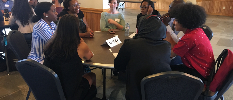 A group of students engaged in a roundtable discussion