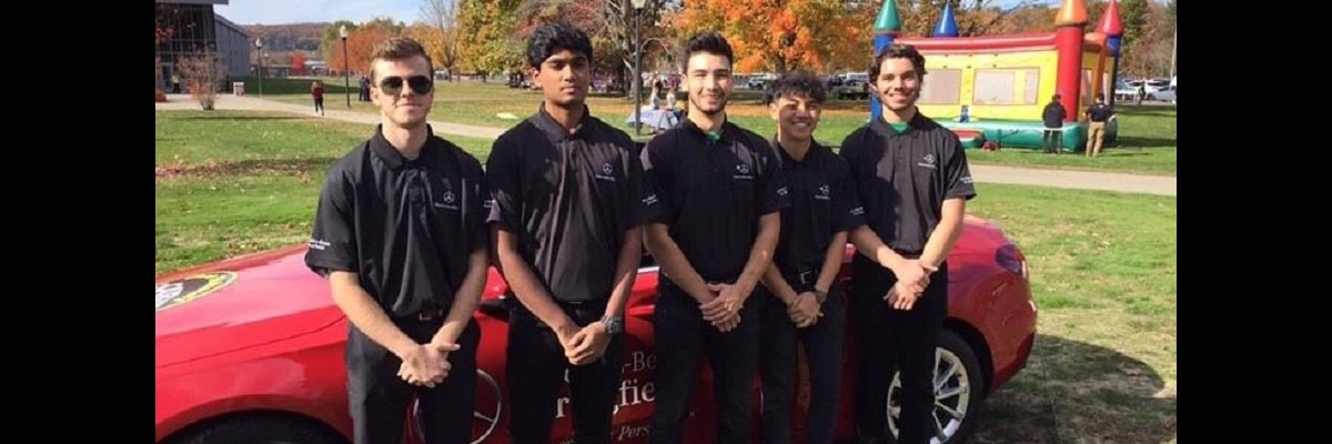 Fraternity standing in front of car