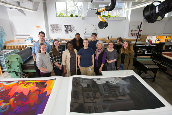 Caitlin Cherry (rear, left) in the printmaking studio with Juana M. Valdes, Assistant Professor of Art; Mikaël Petraccia, Printmaking, Digital and Photo Technician; Lauren Bennett (MFA '16), project assistant; Loretta Yarlow, UMCA Director; Alexis Kuhr, Chair of Art Department; and art students. Photos by John Solem.