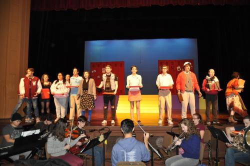 "Cast of ""Heathers: The Musical"" performing alongside student musicians."