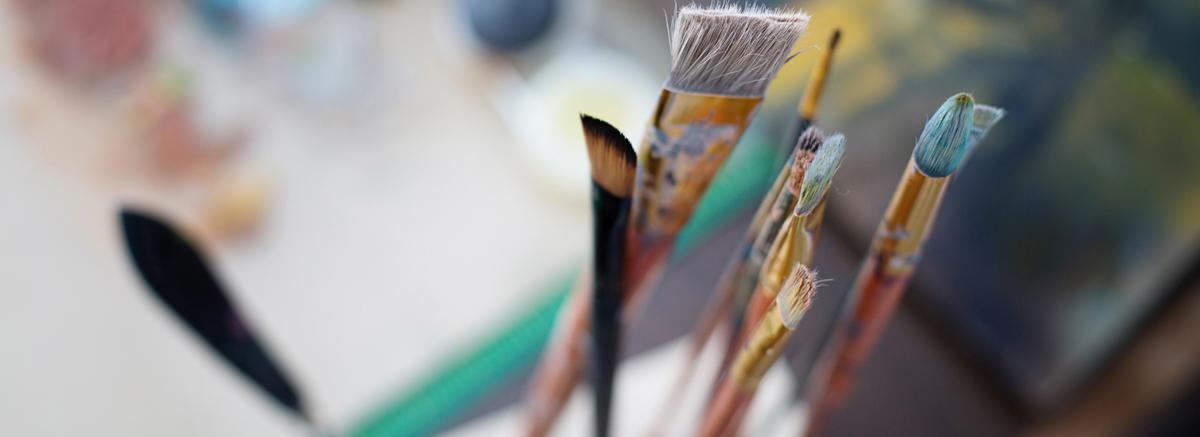 Close up of used paint brushes