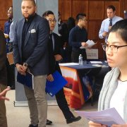 A student interacts with a recruiter at a Career Fair