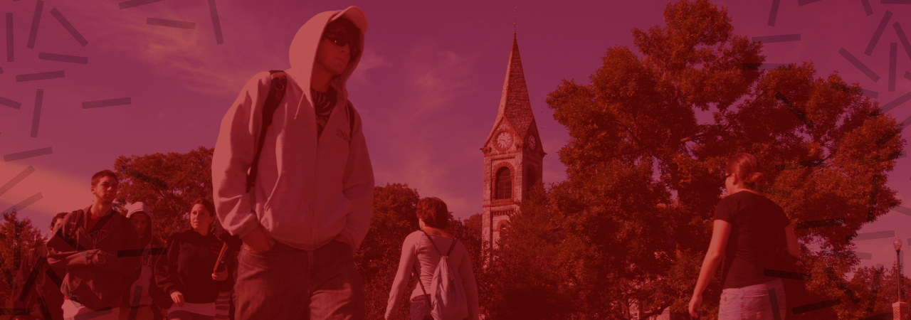 Students walk through campus in front of Old Chapel