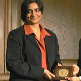Banu Subramaniam shown receiving a medal from UMass Amherst Chancellor Kumble Subbaswamy