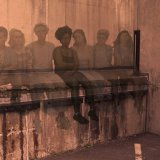 a group of students sit on a ledge, manipulated to seem transparent