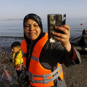 Woman taking a selfie after arriving on shore