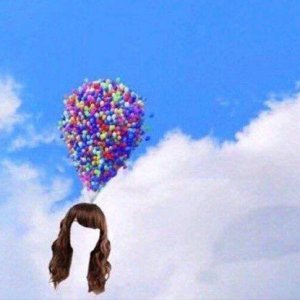 a wig towed into the sky by balloons
