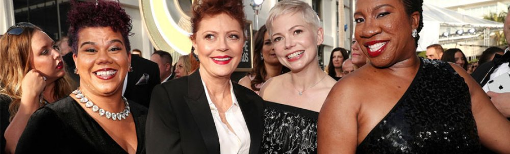 Rosa Clemente on the Golden Globes red carpet with Susan Sarandon, Michelle Williams, and Tarana Burke.
