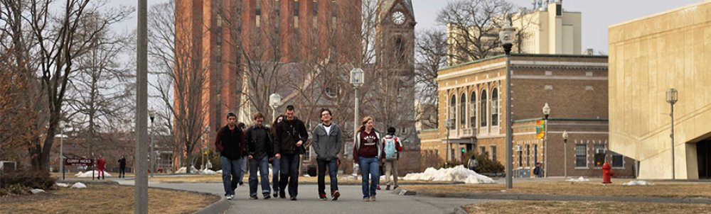 A group of student walking across campus from the Library