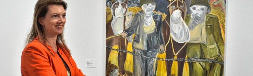 """Karen Kurczynski presenting """"Human Animals: The Art of Cobra and its Legacy,"""" an exhibition she curated for the University Museum of Contemporary Art in 2016"""