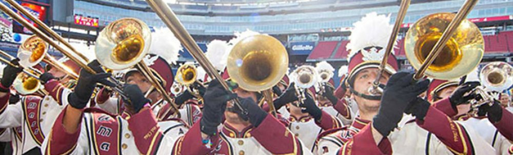 Close up of the trombone section of the Minuteman Marching Band during a performance