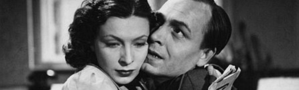 Still from the film Marriage in the Shadows showing a man and a woman embracing.