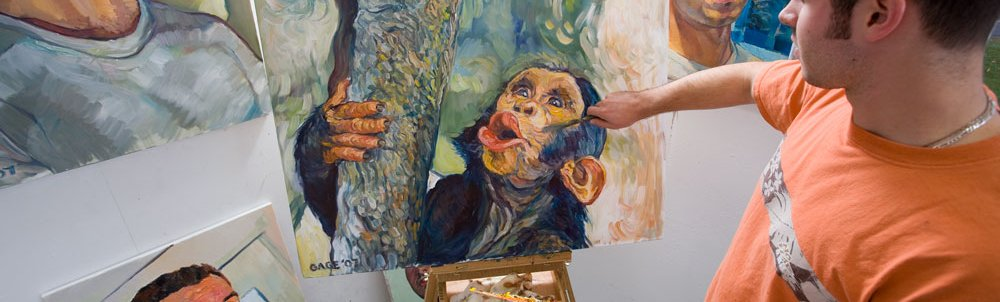 An art student works on a picture of a monkey.