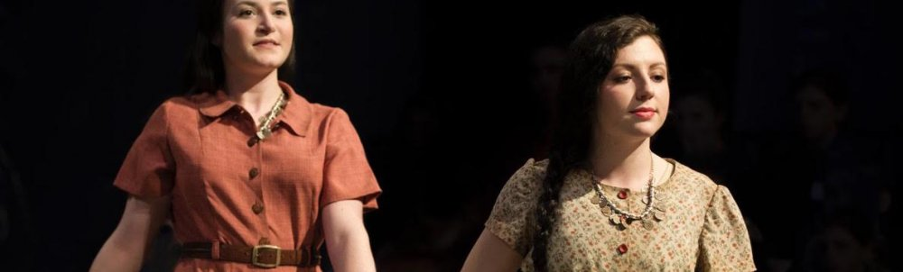 two student actresses on stage in Refugee