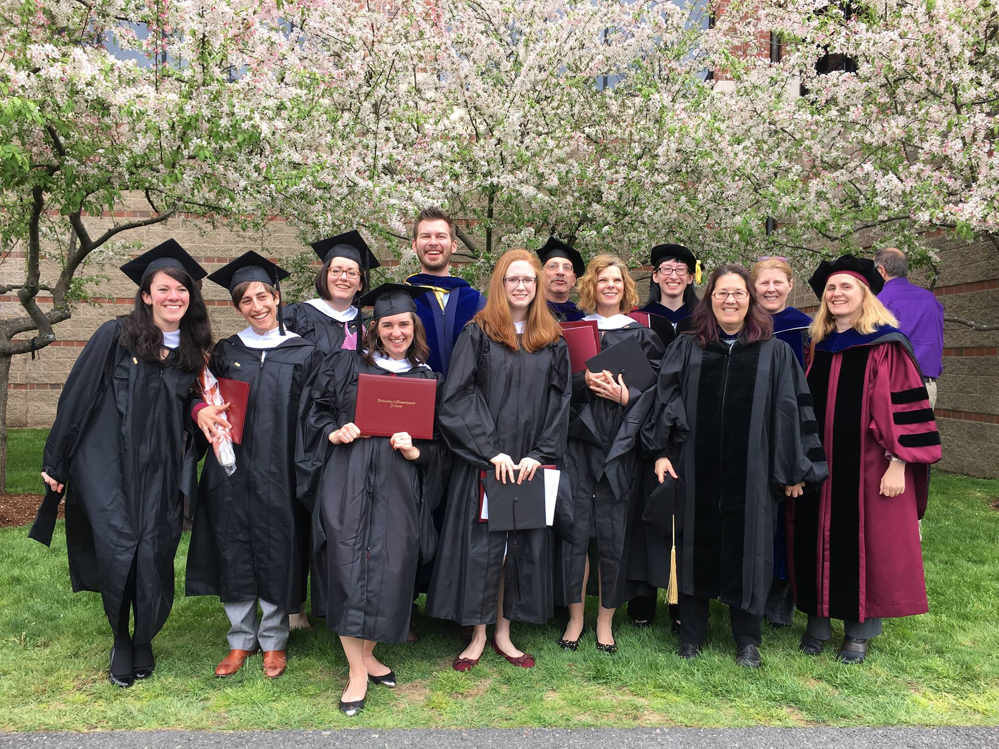 Group shot of 2016 public history graduates in academic regalia