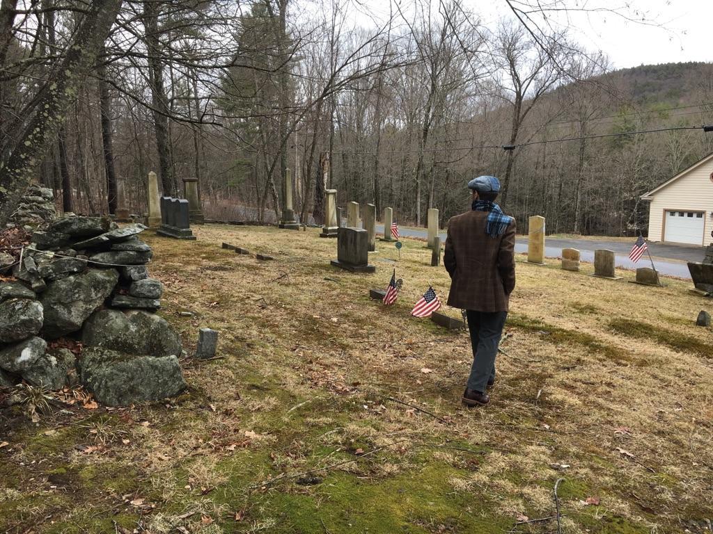 Photo of Austin Clark in a cemetery