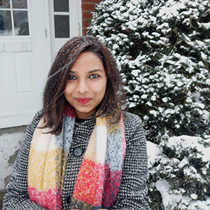 Profile image of Fulbright-Nehru Doctoral Research Fellow Parul Srivastava in the front of a snow covered tree and entry door in the background.