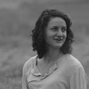 Headshot of Perri Meldon in a field