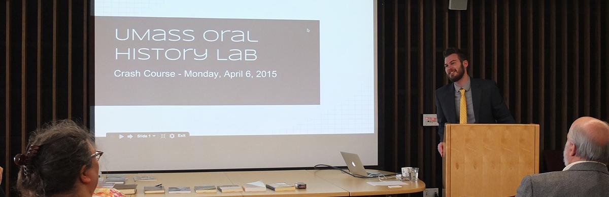 Professor Samuel Redman giving a talk in front of a PowerPoint slide