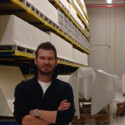 Sam Redman in a warehouse of material archives