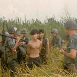 A group of South Vietnamese army soldiers and an American soldier with two captured Vietcong suspects, in Plaines des Joncs, South Vietnam.