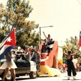 Contingent representing several Latin American countries, with float like giant shoe, annual Seattle LGBT Pride parade, Capitol Hill, Seattle, Washington, 1995.