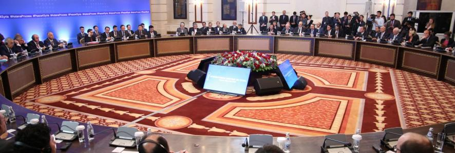Big circle meeting room with people in suits