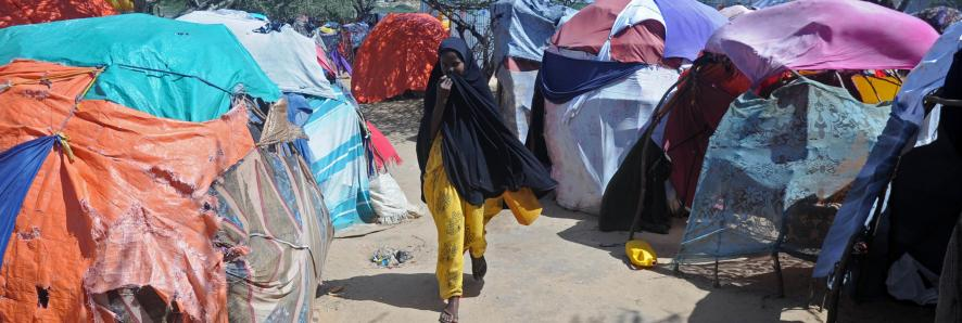 A displaced Somali woman  at a camp in the Garasbaley area on the outskirts of the capital Mogadishu