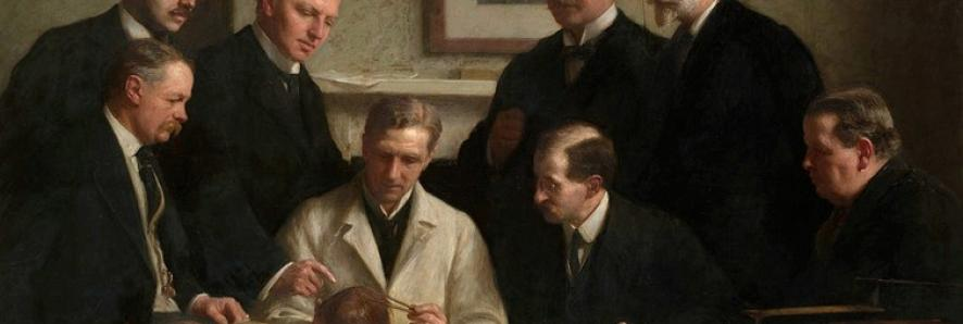The portrait painted by John Cooke in 1915. Back row: (left to right) F. O. Barlow, G. Elliot Smith, Charles Dawson, Arthur Smith Woodward. Front row: A. S. Underwood, Arthur Keith, W. P. Pycraft, and Sir Ray Lankester. Note the painting of Charles Darwin