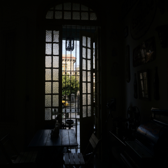 View through a window at a Cafe in Vedado, Cuba