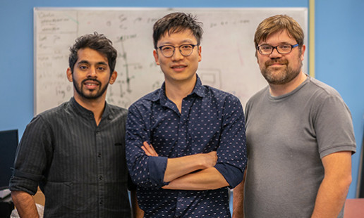 UMass Amherst Assistant Professor Sunghoon Ivan Lee (center) was looking for ways to make smaller, lighter, more energy-efficient wearable sensors. His team's research revolves around a novel concept of wirelessly transferring current through human skin to power battery-less wearable sensors.