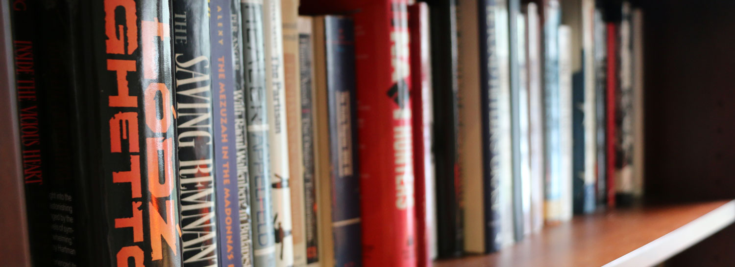 books on a shelf at the Institute for Holocaust, Genocide, and Memory Studies
