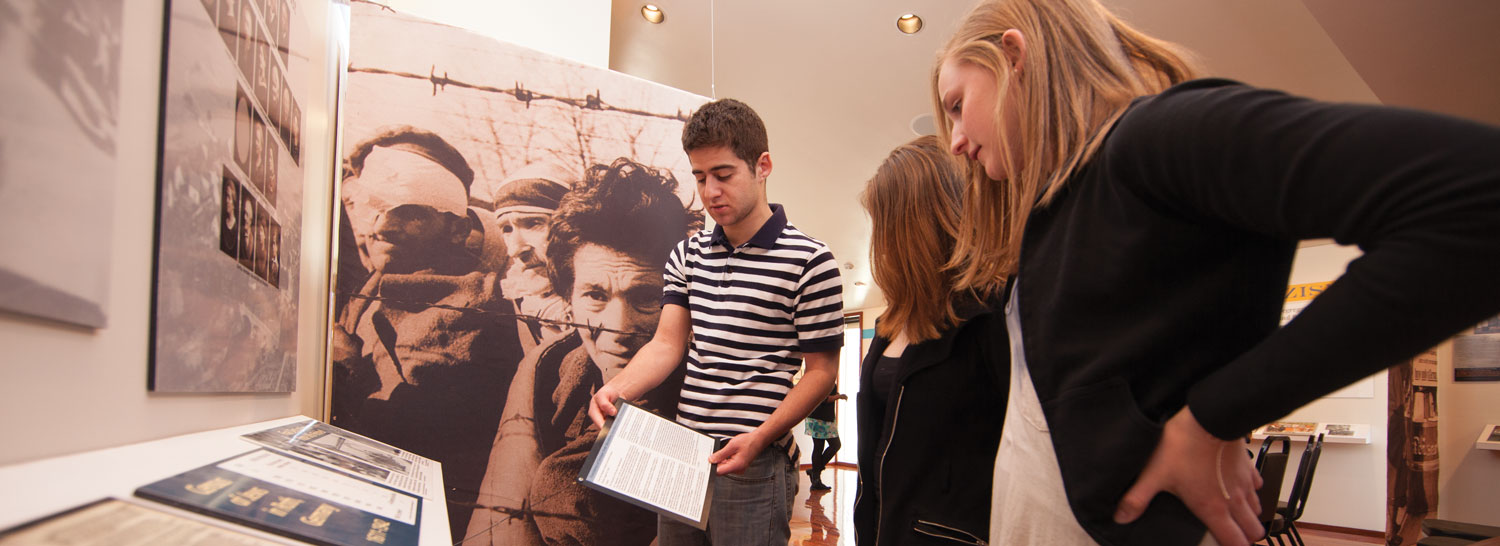 Students interact with the permanent exhibition, A Reason to Remember.