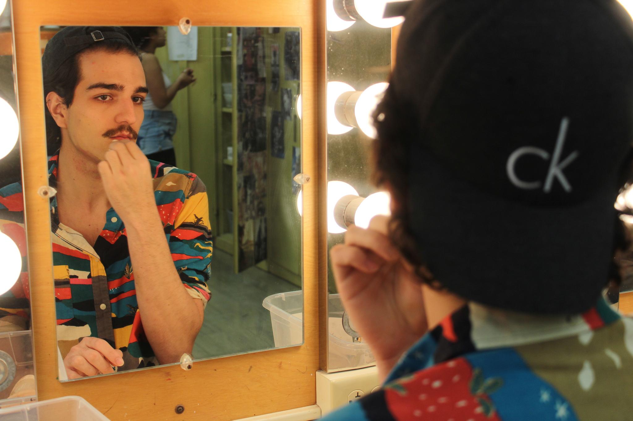 UMass Amherst student Lucas La Guardia prepares for a show