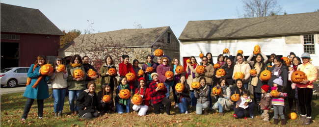 Students from the International Programs Office at UMASS Amherst with pumpkins