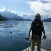 A student by a lake