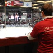 Students at a UMass Amherst Hockey game